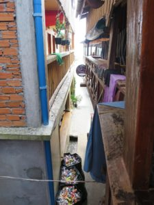 Alleys between accommodation smell faintly of sewage and are littered with rubbish bins, laundry lines and drying clothes.
